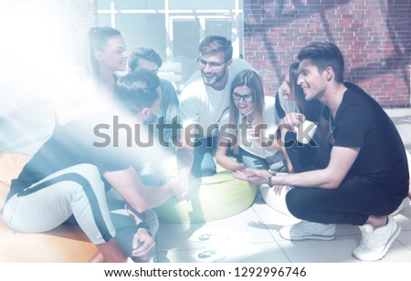 friends shaking hands when discussing a new project.? #1292996746