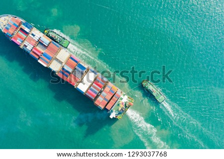 Aerial view and top view. Container ship in pier with crane bridge carries out export  and import business in the open sea. Logistics and transportation #1293037768