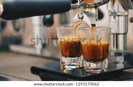 Cup of coffee espresso with espresso machine. Espresso on black scale. Vintage tone style #1293170062