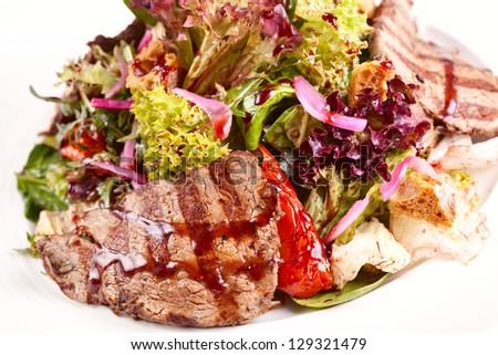 Warm salad with beef #129321479