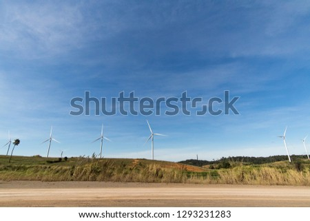 View of wind turbines in beautiful landscapes. Background with space. Concept of renewable energy, green energy. #1293231283