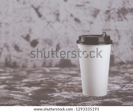 Working on the go. Coffee cup on grey stone table. Copy space. #1293335191