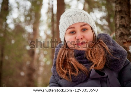 Portrait of a girl in a pine forest on a winter day. Single walk #1293353590