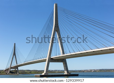 International Bridge, linking Portugal and Spain over the Guadiana river. Royalty-Free Stock Photo #129339917