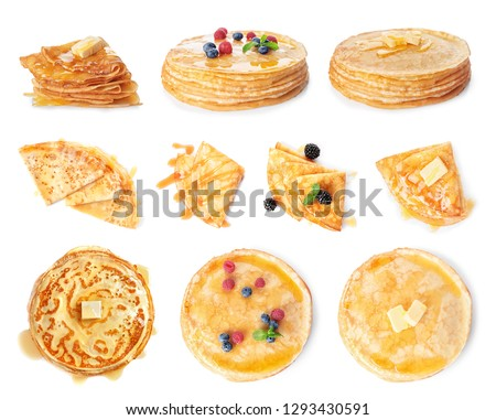 Set of tasty thin pancakes with different toppings on white background #1293430591