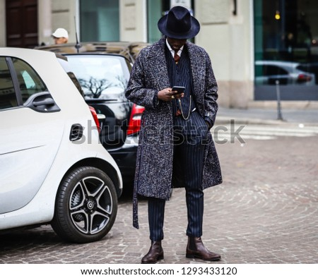 MILAN, Italy- January 13 2019: Men on the street during the Milan Fashion Week. #1293433120