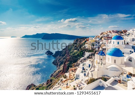 Churches in Oia, Santorini island in Greece, on a sunny day. #1293455617