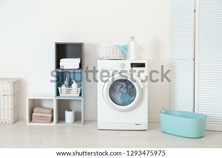 Washing of different towels in modern laundry room #1293475975