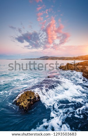 Unusual vivid clouds illuminated by the beams of the sun. Scenic image of textured sky. Location place Island Sicilia, Palermo sity, Italy, Europe. Mediterranean sea. Discover the beauty of earth.