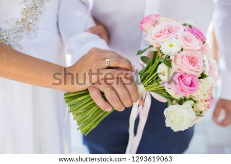 Newlyweds holding a bouquet #1293619063