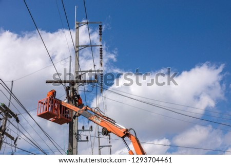 Electrical engineer is practicing maintenance of the power transmission system at Mae Sai District, Chiang Rai Province, Thailand, January 10, 2019 #1293704461