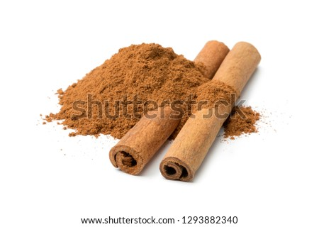 Heap of ground cinnamon and cassia cinnamon sticks isolated on white background #1293882340