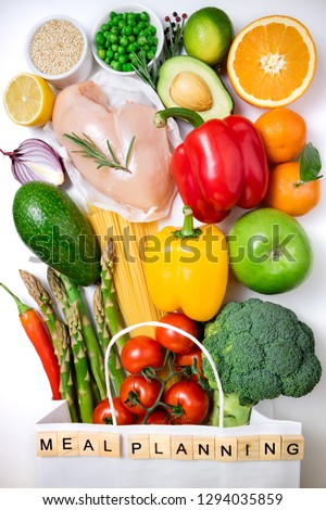 Healthy food background. Healthy food in paper bag meat, fruits, vegetables and pasta on white background. Shopping food supermarket and meal planning concept. Top view #1294035859