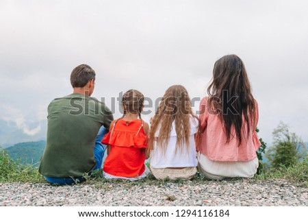 Family vacation. Family of two parents and two kids enjoy the view in mountains #1294116184