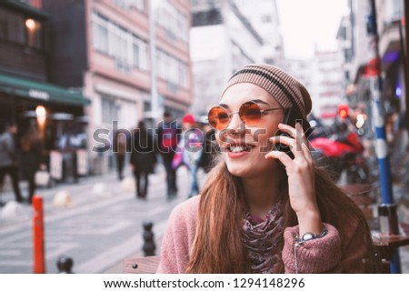 Young portrait woman talking mobile phone in outdoors #1294148296