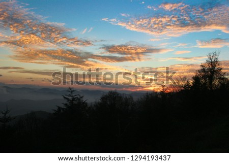 This is one of the many stunning sunsets I have seen along the Blue Ridge Parkway in NC. The Smoky Mountains look true to their name in the background. #1294193437