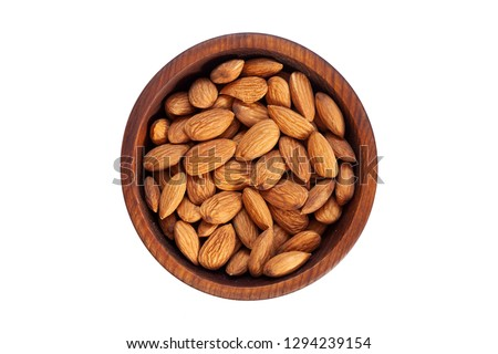 Peeled  almond  in a wooden cedar plate on a white isolated background. Row of bowls with almond  nuts, top view. Peeled  almond pattern #1294239154