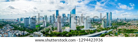 Aerial View of Jakarta Downtown Skyline with High-Rise Buildings With White Clouds and Blue Sky, Indonesia, Asia #1294423936