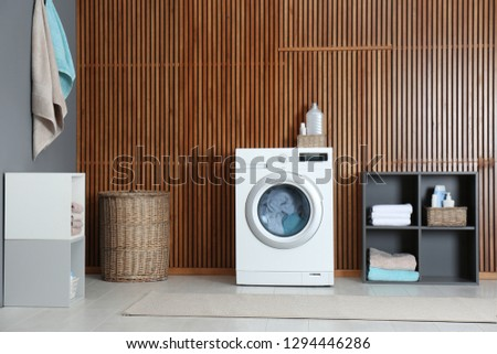 Washing of different towels in modern laundry room #1294446286