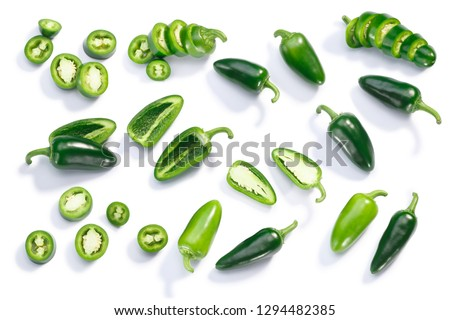 Jalapeno chile pepper (Capsicum annuum fruits), whole, chopped, halved, and sliced pods, top view, isolated #1294482385