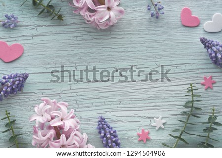 Pearl and grape hyacinth flowers and eucalyptus leaves on light textured background, copy-space #1294504906