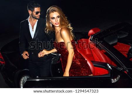 Couple in luxury car. Night life. #1294547323