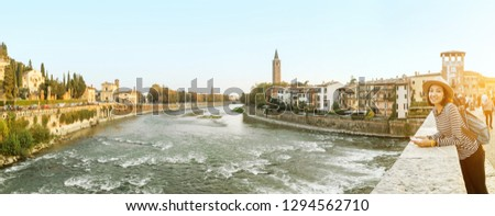 Panoramic cityscape view of Verona old town and bridge over Adige river. Travel destination in Italy concept #1294562710