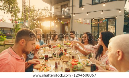 Big Family Garden Party Celebration, Gathered Together at the Table Relatives and Friends, Young and Elderly are Eating, Drinking, Passing Dishes, Joking and Having Fun. #1294608067