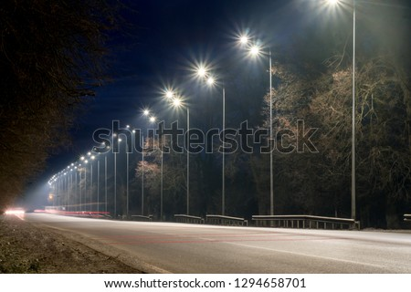 street lighting, supports for ceilings with led lamps. concept of modernization and maintenance of lamps, place for text, night. winter season. energy-saving lamps, safety of movement #1294658701