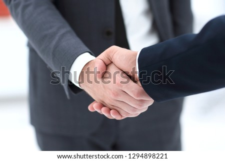 close up of two young male business partner shake hand #1294898221