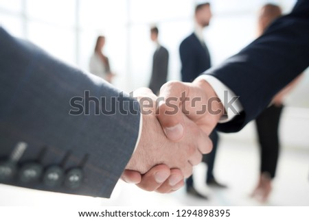 close up. handshake of business partners #1294898395