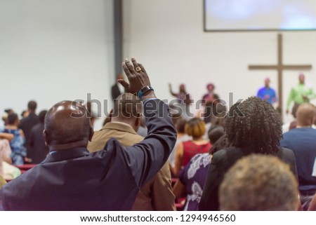 African American Man at Church with His Hand Raised Royalty-Free Stock Photo #1294946560