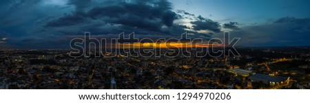panoramic photo of sunset in Brazil, with many clouds and early evening, made by drone at 120 meters high. #1294970206