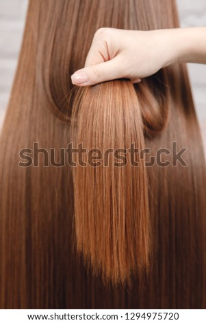 Close-up hair texture of blond blonde, European model after procedure for ruling. #1294975720