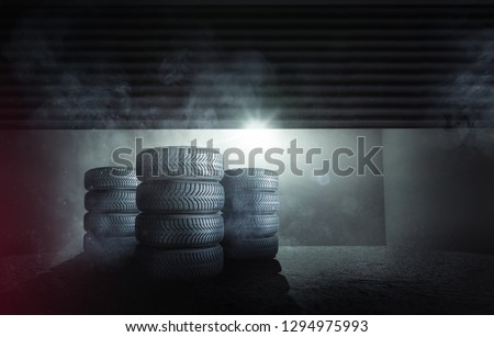 Car tires in front of a garage #1294975993