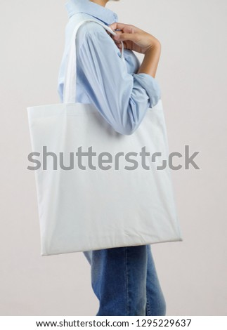 woman holding eco fabric bag isolate on gray background #1295229637