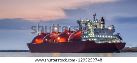 LNG TANKER - Ship at dawn moored to the gas terminal #1295259748