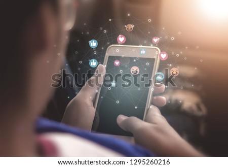Young women using phones to broadcast live social media concepts, smartphones, social media, social networking concepts with smartphones  #1295260216