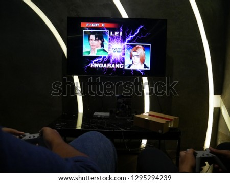 Jakarta, Indonesia - January 26, 2019: Playing Tekken 3 video game on Sony Playstation Classic.  #1295294239