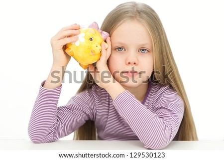 Picture of lovely small girl with piggy bank