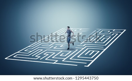 Man running through the middle of a labyrinth. The concept of shortcut and working smart.  Royalty-Free Stock Photo #1295443750