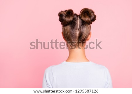 Rear back behind view of nice attractive groomed girl wearing two fashionable buns isolated over pink pastel background #1295587126