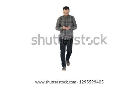 Young man walking and using a phone, messaging on white background.