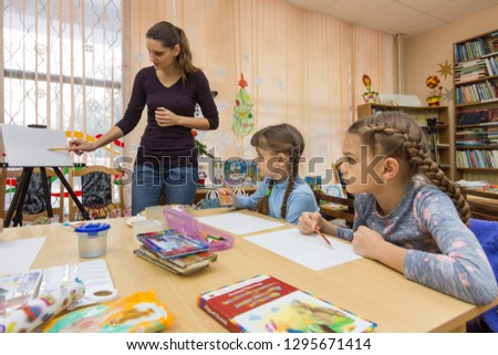 The teacher tells the students how to draw #1295671414