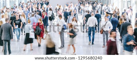 large crowd of anonymous blurred people