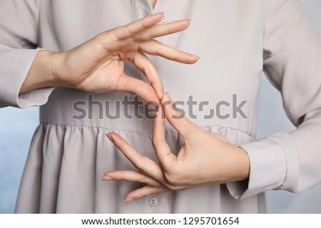 Woman showing word interpreter, closeup. Sign language