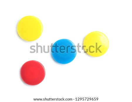 Bright magnets on white background, top view