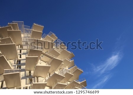 """Outdoor view of the new building under construction called """"l'arbre blanc"""", the white tree in english, located in Richter district, Montpellier city, France. January, 25, 2019. Modern design.  #1295746699"""