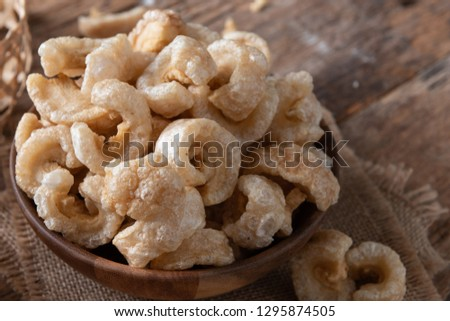 Pork rinds also known as chicharon or chicharrones , deep fried pork skin , kab moo #1295874505