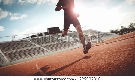 Sport Backgrounds, Male runner ready for sports exercise, Athlete running on athletic track. #1295902810